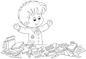 Ученик наводит порядок на столе