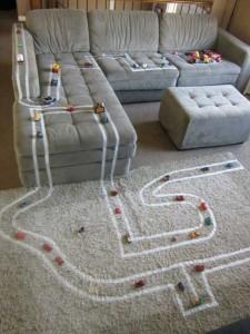 Детская дорого прямо на ковре и диване